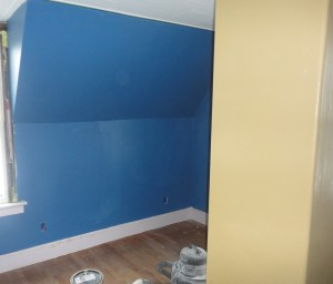 Will's room with a first coat of paint on the walls. The chimney in the foreground is the accent color