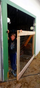 Will helping show off the new dog pen door.