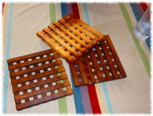 Completed 7-inch square trivets (two from walnut and one from possible maple)