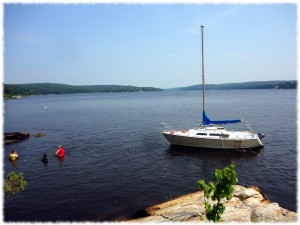 The view of the sailboat at anchor from our picnic spot