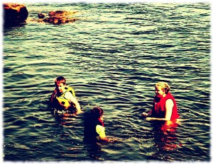 Susanna and the boys playing in the water.