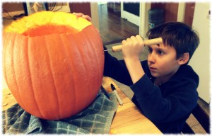 Ben working on carving his pumpkin.