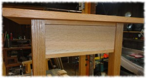 Drawer front fitted to the opening