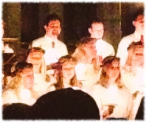 Susanna (bottom right) singing by candlelight at the Lucia celebration