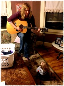 Susanna singing to Michael in the living room.  I'm pretty sure I need to tune the guitar, but Michael didn't seem to mind.