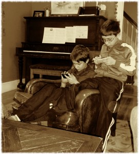Will and Ben enjoy a quiet moment on their iPods this morning.
