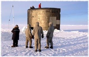 Waiting for the hatch to be cleared of ice before going onboard the submarine for testing under the ice.