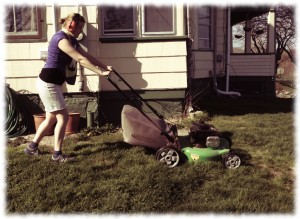 Susanna mowing the grass..
