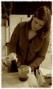Susanna putting a varnish finish on the second toy box for her preschool.