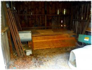 The lumber pile/junk storage/dog pen prior to reorganization.