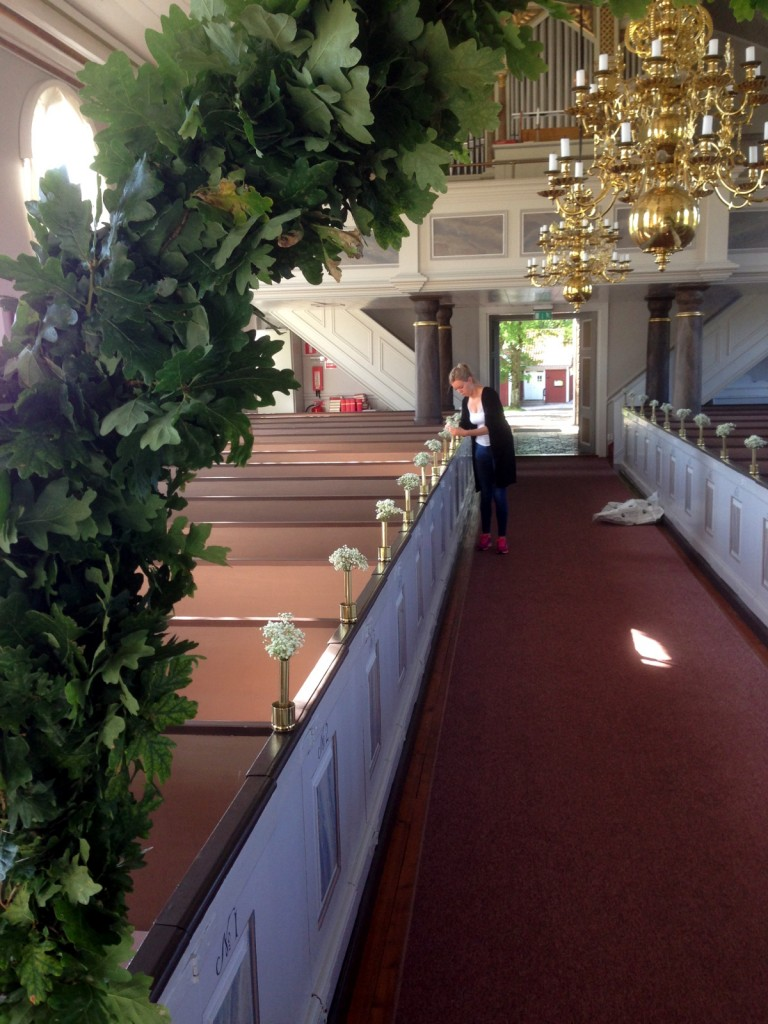 Susanna's sister, Sofia, setting up flowers at the church the day before her wedding.