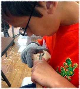 Ben hard at work carving his dog.