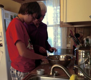 Will and his grandmother working on making apple crisp