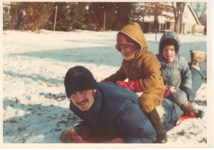 My dad sledding with Bill and me