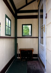 The porch color scheme (Sherwin-William's Concord Buff, Rookwood Dark Green, and Rookwood Brown). The painting scheme was planned by Susanna.