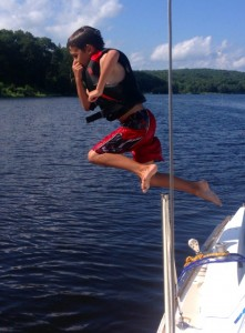 Ben jumping off the boat