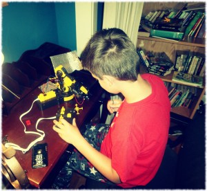 Will playing with his robot arm after completing the project.