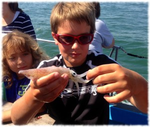 Will showing off one of the squids found while trawling in Long Island Sound with Project Oceanology.