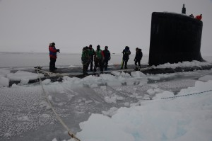 140322-N-RB579-323 ICE CAMP NAUTILUS (March 22, 2014) Sailors aboard the Virginia-class attack submarine USS New Mexico (SSN 779) tie mooring lines after the submarine surfaces through the arctic ice during Ice Exercise (ICEX) 2014. ICEX 2014 is a U.S. Navy exercise highlighting submarine capabilities in an arctic environment. (U.S. Navy photo by Mass Communication Specialist 2nd Class Joshua Davies/Released)