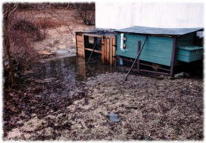 The stream behind the barn flooding out the bottom of the chicken coop.