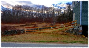 The new fence, ready to let the weather gray the wood.