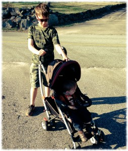 Will pushing Michael on our walk down the street. He needed a snack and a break from his brother.