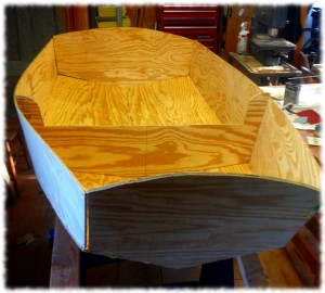 The rough shape of the boat begins to form with all the major pieces stitched in place.