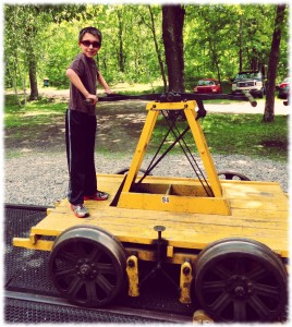 Ben on the handcar. We were able to take the car up and down the track.