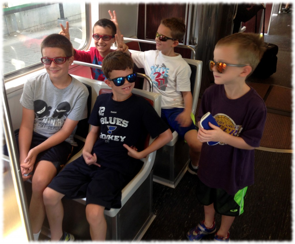 "On Monday, we headed into Boston. Here is a picture of the boys on the ""T"" (MBTA) heading into the city."