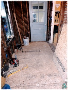 mud room with new subfloor installed.
