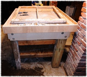 Side view of workbench. The rear legs are from a 4x6 post I had - the bench is very solid.