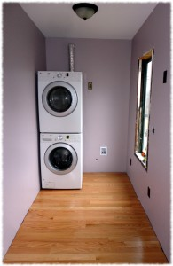 Laundry/Mud Room with the walls painted, floor installed and washer and dryer.