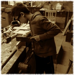 Ben sawing the legs of his shaker shop stool