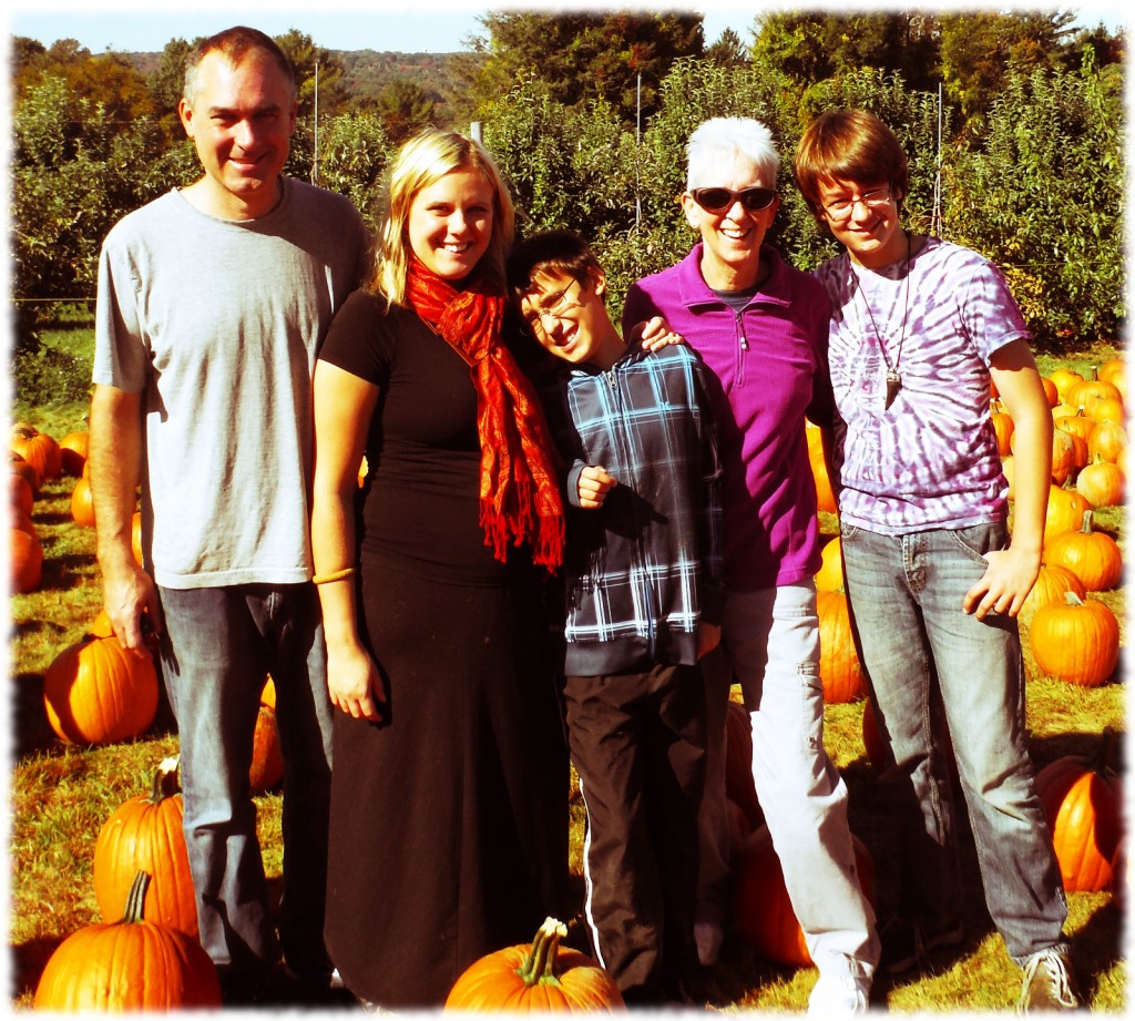The whole family enjoying the perfect fall weather at the apple orchard.