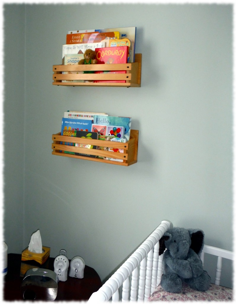 Book display shelves installed in the corner of the nursery.