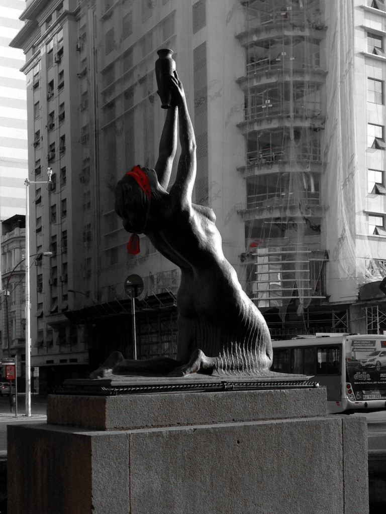 Statue in Rio de Janeiro with her eyes covered by a red blindfold as a part of a protest against the government.
