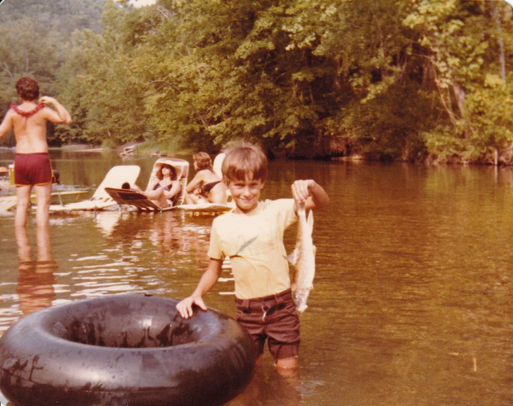 "Chuck Curtis and his ""catch"" - Current River canoe trip (1980)"
